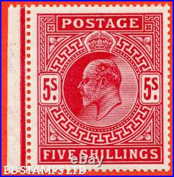SG. 318 Variety M52 (1). 5/- Carmine Red. A very fine UNMOUNTED MINT left B56021